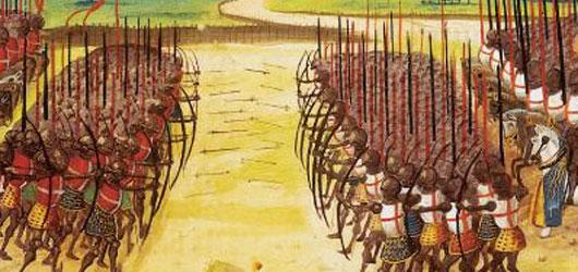 25 octobre 1415. Azincourt! La <em>«fleur de la chevalerie française»</em> est non seulement défaite mais égorgée par les Anglais. <br /><br />Avec cette bataille, c'en est fini des osts féodales. Place aux soldats de métier...<br /><br />En savoir plus : <br />cliquez sur l'image