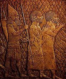 Prisonniers juifs sous la garde d'un officier assyrien