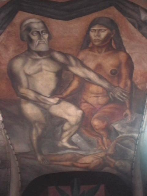 La Malinche et Cortès. Détail mural du collège San Ildefonso (00273), Huichol19, Mexique, 2005. La Malinche (ou Malintzin), appelée Dona Marina par les conquistadors espagnols, esclave amérindienne d'un cacique maya, devint en 1519, la maîtresse de Hernan Cortes avec qui elle eut un fils. Son rôle d'interprète et de conseillère fut déterminant dans la conquête espagnole du Mexique.