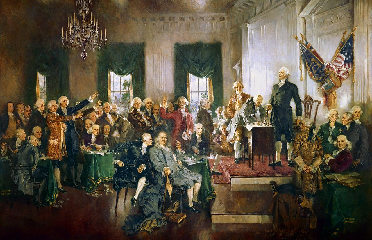 Signature de la Constitution des États-Unis en 1787, Howard Chandler Christy, 1940, Capitole, Washington. Debout sur l'estrade, George Washington, assis devant lui, au centre, de gauche à droite, Alexander Hamilton, Benjamin Franklin et James Madison.
