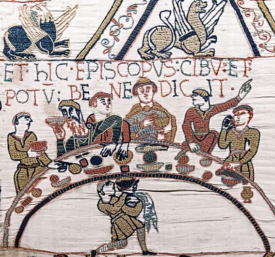 Détail de la Tapisserie de Bayeux (légende en latin ET HIC EPISCOPUS CIBU[M] ET POTU[M] BENEDICIT (Et ici l'évêque bénit la nourriture et la boisson), 1070, Bayeux, musée de la Tapisserie de Bayeux.